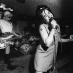 Kathleen Hanna (right) singing live with Bikini Kill in the early '90s.